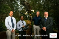 Just Wild 2014 event photo of people standing with the eagle mascot Freedom